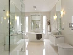 A modern bathroom is thus not only a place where people can go for a refreshing shower but a place of serenity and complete relaxation. Checkout 35 best modern bathroom design ideas - March 08 2019 at Modern Bathtub, Modern Bathroom Design, Bathroom Interior, Bathroom Designs, Bath Design, Modern Design, Modern Shower, Tile Design, Freestanding Bathtub