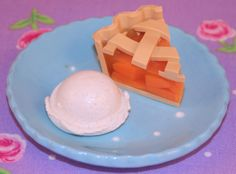 Peach Pie A La Mode - This peachy confection is enveloped in flaky, buttery crust and served with a scoop of vanilla ice cream. This is the perfect ending to any meal!