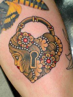 traditional style tattoo-heart lock
