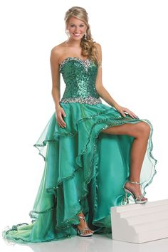 ad59e73e84 A gorgeous hi-low organza prom dress by Karishma. The bodice is embellished  with matching green sequins.