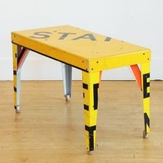 BORIS BALLY Rectangular Transit Table >> PROVIDENCE, RI >> Boris Bally transforms discarded, often vandalized street signs into functional and artful home furnishings. Traffic signs, champagne corks, and steel hardware are completely hand fabricated and finished into lightweight, geometric accent tables. Great graphic pops make an accent in the man cave or as a modern touch in a foyer. For NuBe Green