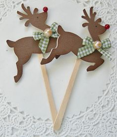 "Here are 2 handmade Reindeer Lollipop embellishments/cupcake toppers.  These adorable embellishments are great for scrapbooking, cardmaking, gifts and many other projects.  Each Lollipop measures approx. 3""  Need a larger quanity or diffrent color just convo me and I will see what i can come up with.  Thanks for taking a peek!!!"