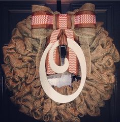 Burlap wreath with painted wooden letter and simple bow.