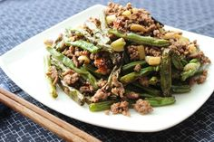 This spicy ground beef and green beans is one of the most popular dishes in China, originated from Szechuan cuisine. It is also one of my favorite dishes. Ground Beef And Green Bean Recipe, Spicy Green Beans, Green Bean Recipes, Ground Beef Recipes, Pork Recipes, Asian Recipes, Cooking Recipes, Healthy Recipes, Oriental Recipes