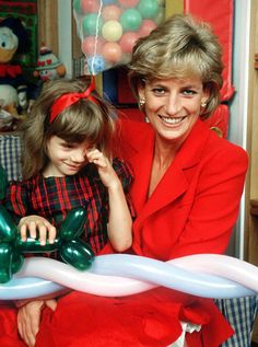 Princess Diana holds the child of an HIV patient at the London Lighthouse, a centre for people affected by HIV and AIDS, in London, in October 1996   Picture: Jayne Fincher/Getty Images