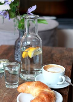 easy breakfast: fruit infused water, cappuccino and croissant