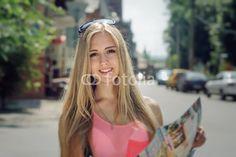Photo: Girl considers the tourist map and smiling Tourist Map, Stock Photos, Image, Fashion, Moda, Fashion Styles, Fashion Illustrations