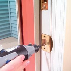 When a house settles, doors sometimes stop latching properly because one side of the frame has sagged. You can fix the problem easily with a rotary tool and a metal-cutting bit.