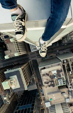 would NEVER do this but what an awesome shot! love how he included his feet in there for perspective. :)