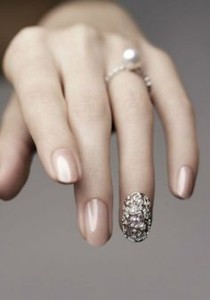 I would love to try this, it looks so refined and lovely, a more subtle approach to nail art
