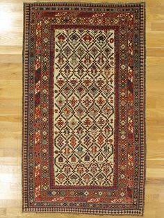 "Shirvan rug,Eastern Caucasus,West Coast of the Caspian Sea,dated 1302=1884.Dimensions: 6'.9""x3'.11"" (206x119 cm). 