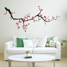 A beautiful tree branch with flowers is the perfect design for any room!