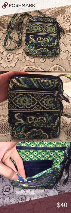 Vera Bradley cross body bag. Vera Bradley cross body purse. Never used, excellent condition-no damage or flaws. Has 3 zipper compartments with 4 overall. Front part has clear ID holder with card holders as well. For a smaller bag it can certainly store a lot! Vera Bradley Bags Crossbody Bags
