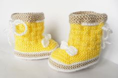 Knitted baby booties in soft yellow by Svetlanababyknitting, $20.00