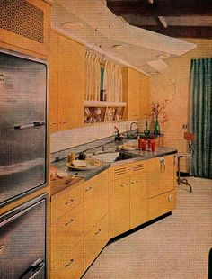 SO much to love. Look above the cabinets at the lighting strip. Look now at the angle-fronted bric-a-brac shelf over the sink. Note the right angled dish sink; now note the prep sink with a stool in front of it. How about the built in fridge/freezer combo?