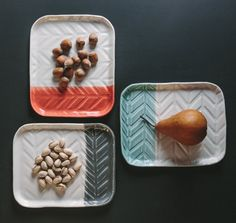 The Herringbone Tray is a hand-built tray with a custom pattern pressed into a beautiful white porcelain and glazed with a dip of color on the one end.