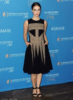 Taking risks: Heida Reed, 28, absolutely stunned in a structured black dress…