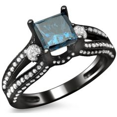 Beautiful and classy, this engagement ring features a blue princess cut diamond surrounded by of round diamonds. Meticulously set in black rhodium-plated gold, this ring is completed b Blue Wedding Rings, Blue Rings, Dior Star, Expensive Rings, Princess Cut Diamonds, Blue Diamonds, Round Diamonds, Black Gold Jewelry, Pretty Rings