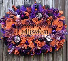 I wanted to create an extravagant, extraordinary, exploding Halloween wreath.....and I am so excited to present this one to you! The wreath was