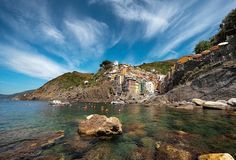 Where do the rocks end and the buildings begin in the town of Riomaggiore, Cinque Terre?