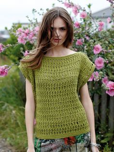 Crochet this womens casual tee style top from Summer Textures, a design by Sarah Hatton using the lovely yarn All Seasons Cotton (cotton and acrylic). With a simple yet effective stitch pattern throughout and cute cap sleeves, this crochet pattern is for the beginner crocheter. (Make into crop top)
