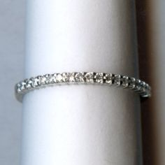 Classic white gold diamond wedding ring. Available at Argo & Lehne Jewelers.