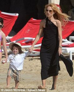 Rachel Zoe - Never in a bikini: On Monday, the mother-of-one covered up in a black sarong, and in Miami on Sunday, her collarbone and ribs were clearly visible in a baggy maxi-dress