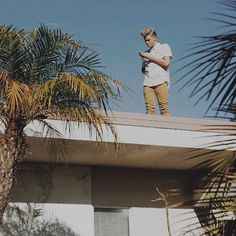 Are we all ignoring the fact that he's on a roof?
