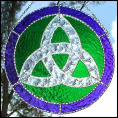 """Handcrafted Blue & Green Stained Glass Trinity Knot Suncatcher - Celtic Design- 9 1/2"""" - $38.95 --- Celtic Designs, Irish Designs, Irish Sun Catchers - Glass Suncatchers, Stained Glass Décor, Stained Glass Sun Catchers -  Stained Glass Design - See more stained glass designs at www.AccentonGlass.com"""