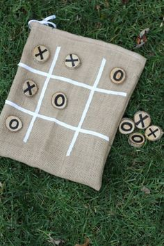 Homemade tic-tac-toe game in bag. To make it more ESL, use different images -- cats and dogs, for example. Or something a little harder to pronounce!