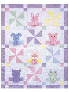 "Pattern includes easy tips for stitching 6 adorable animal faces, along with machine applique instructions to make a 36"" x 46"" quilt."