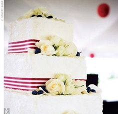 The three-tiered square cake was decorated with red-and-white-striped ribbon, white roses, and blueberries on each tier. Seaside Wedding, Red Wedding, Wedding Bells, Wedding Fun, Wedding Stuff, Wedding Ideas, Christmas Wedding Cakes, Ribbon Cake, Square Cakes