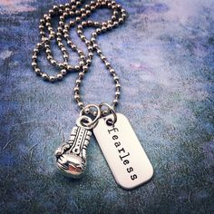"From my signature line of FEARLESS jewelry! This unisex necklace is a great gift for ""Fearless"" MMA fighters, or anyone who trains muay thai, boxing, or kickboxing, etc. A silver boxing glove accompanies my hand-stamped silver ""fearless"" tag. The perfect METAL MOJO to inspire your training sessions or give as a gift to empower a training partner or instructor!"