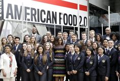 U.S. first lady Michelle Obama, center, poses for a photo with workers of the United States pavilion at the 2015 Expo in Rho, near Milan, Italy, Thursday, Ju...