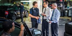 Brothers work business territory and witness to a mechanic in an auto repair shop