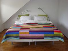 i love all of Ann's quilts. must be the colors and big chunky pieces.  this could be knitted