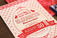 red and white birth announcements designed by Kate Holgate