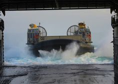LCAC approaches USS Carter Hall    ATLANTIC OCEAN 03/13/13 -landing craft air cushion (LCAC) enters the well deck of the amphibious dock landing ship USS Carter Hall (LSD 50). Carter Hall is deployed as part of the Kearsarge Amphibious Ready Group w\embarked Marines from the 26th Marine Expeditionary Unit (26th MEU) supporting maritime security operations & theater security cooperation efforts in the US 5th & 6th Fleet areas of responsibility. (US Navy photo by Chelsea Mandello)