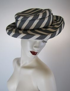 Elsa Schiaparelli couture summer hat | France, circa 1940 | The curvilinear design of the raw silk cotton print and the hat shape itself embodies a striking 'cartwheel in motion'  look.  The hat was also created to carry a particular shape when worn and this is embedded within its frame | The hat bears its original label,  Schiaparelli, 21. Place Vendome, Paris.  Numbered '24311' on back