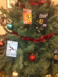 Hunger Games Themed Christmas Tree For Library Christmas Tree Themes Christmas Ornaments Christmas Bulbs