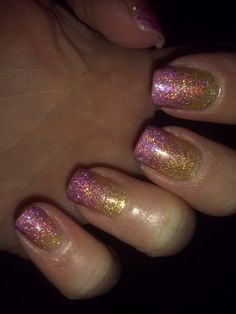 I used Milani 3D nail polish. Painted the gold one coat first, then just layered the pink (even though in the pic it looks purpleish) on top. Two layers of pink on the top, as if I was doing a french manicure, then used the brush to pull some of the still wet pink sparkles down into the gold.