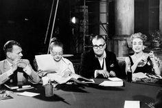 Joseph Cotten, Bette Davis, Robert Aldrich and Joan Crawford rehearsing for the film <em>Hush...Hush, Sweet Charlotte,</em> 1964. From 20th Century-Fox Film Corp/Everett Collection.