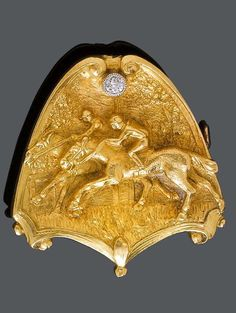 AN ANTIQUE GOLD AND DIAMOND BROOCH, CIRCA 1900. Finely engraved depicting a scene from a horse race, and set with a circular-cut diamond. 2.8 x 2.6 cm. #antique #brooch