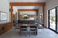 Modern dining room pendant lighting brings added warmth to this sun-filled home in Venice, California. Venice California, Dining Room Lighting, Room Lights, Pendant Lighting, Sun, Modern, Table, Furniture, Home Decor