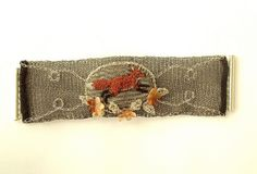 A handmade, one of a kind unusual fox scene crochet wire bracelet. I made the bracelet by crocheting silver plated copper wire for the inside lining and then crocheted and sewed onto wire black mesh fabric a fox scene with carnelian semi precious sto   CLICK on the pic for more details.  http://www.multicolorgems.com