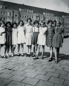 A photo of Anne Frank and her friends who are celebrating Anne's 10th birthday c. 1939. Anne is pictured second to the left in a dark coloured dress. Photo taken by Otto Frank.