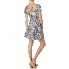 NEW! Floral Fit-&-Flare Dress (M)  **NWT** A feminine floral dress gets an edgy makeover with the low neck, mini hem & cross back! SIZE: Med COLOR:  Multi  FEATURES:    - All-over floral print    - Above-the-knee    - Stretchy, fitted top w/ swing flared skirt    - Scoop-neck    - Off-the-shoulder cap sleeves    - Criss-cross back strap design  MATERIAL:  95% Cotton, 5% Spandex. Machine wash.     ORIG. RETAIL:  $98.00 ~ New With Tags! RVCA Dresses
