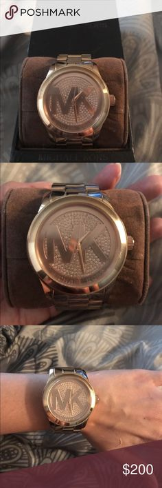 Micheal Kors Rose Gold Unisex Watch Micheal Kora Rose Gold Unisex Watch. Original box included. Normal wear. Watch needs to be re-plated on one side *as shown in pic* Extra links still available for adjustments. Paid $300 KORS Michael Kors Accessories Watches