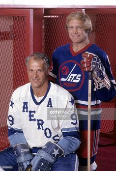 CIRCA 1970's: Bobby Hull #9 of the Winnipeg Jets, standing and Gordy Howe #9 of the Houston Aeros, sitting, pose together for this photo before a WHA Hockey game mid circa 1970's. Hull played for the Jets from 1972-80 and Howe played for the Aeros from 1973-80.