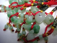Green Jade Feng Shui Gourd These are jade Gourd Feng Shui symbols hanging in silk cords. They can be used for feng shui hangings as well as in other decorative schemes such as adding a good luck symbol to a birthday present, as a bookmark, a pendant, or attaching it to a purse or bag, or as the Feng Shui experts advise, hang these charms in your, home, office or car to enchance positive Chi for health and wealth. The Green Jade Feng Shui Gourd symbolizes good health and fortune.  The silk…
